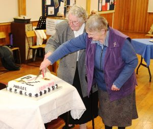 Sister Madeleine and Sister nola cut the cake